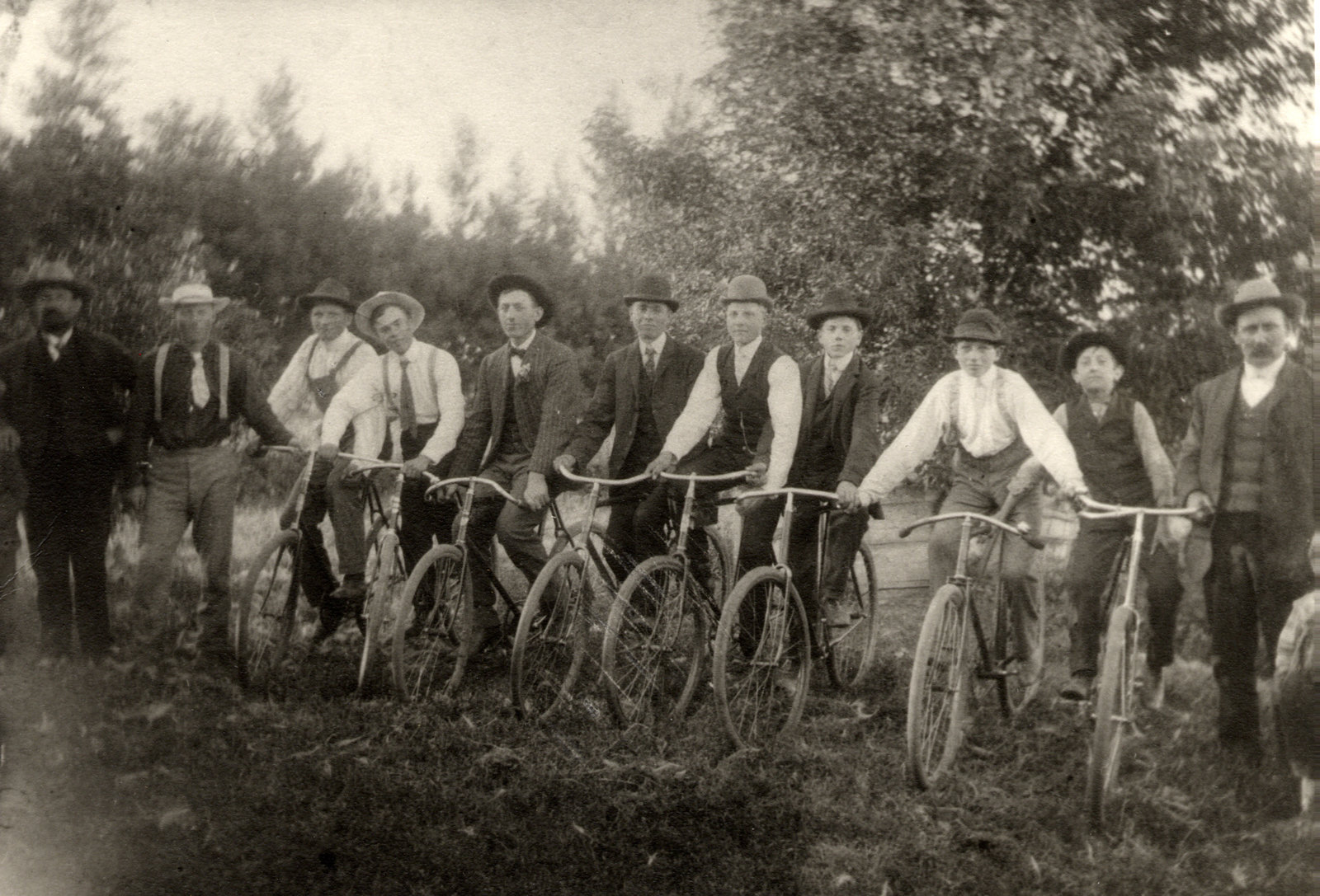 Bicycle club, Wilno, Minnesota, A men's bicycle club on the Anton Mazarek farm in Wilno, Minnesota, 1908. L to R: Sylvester Mazarek; Joseph Bukowski; Anton Otto; Joseph Lasnetski; John Guza; Vincent Panek; William Guza; Michael Guza; Adam Guza; Stanley Lasnetski; Harry Mazarek; Anton Mazarek; Andrew Mazarek. Several of the young men belonged to St. John Cantius Church, 1908, In Copyright