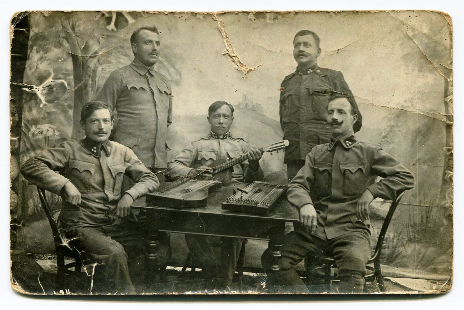 Photograph of Michael Drašček (seated, centre, 3rd from left) with 3 soldiers, undated, Europeana 1914-1918 / Rada Čopi, CC BY-SA