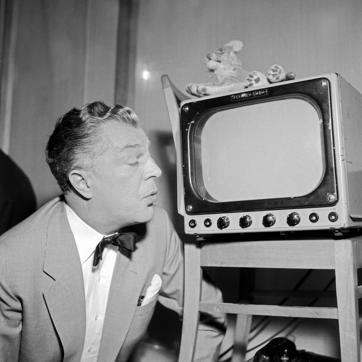 German actor Viktor de Kowa marvels at a small Telefunken television set, Hamburg, 1956 , Siegfried Pilz, United Archives, In Copyright