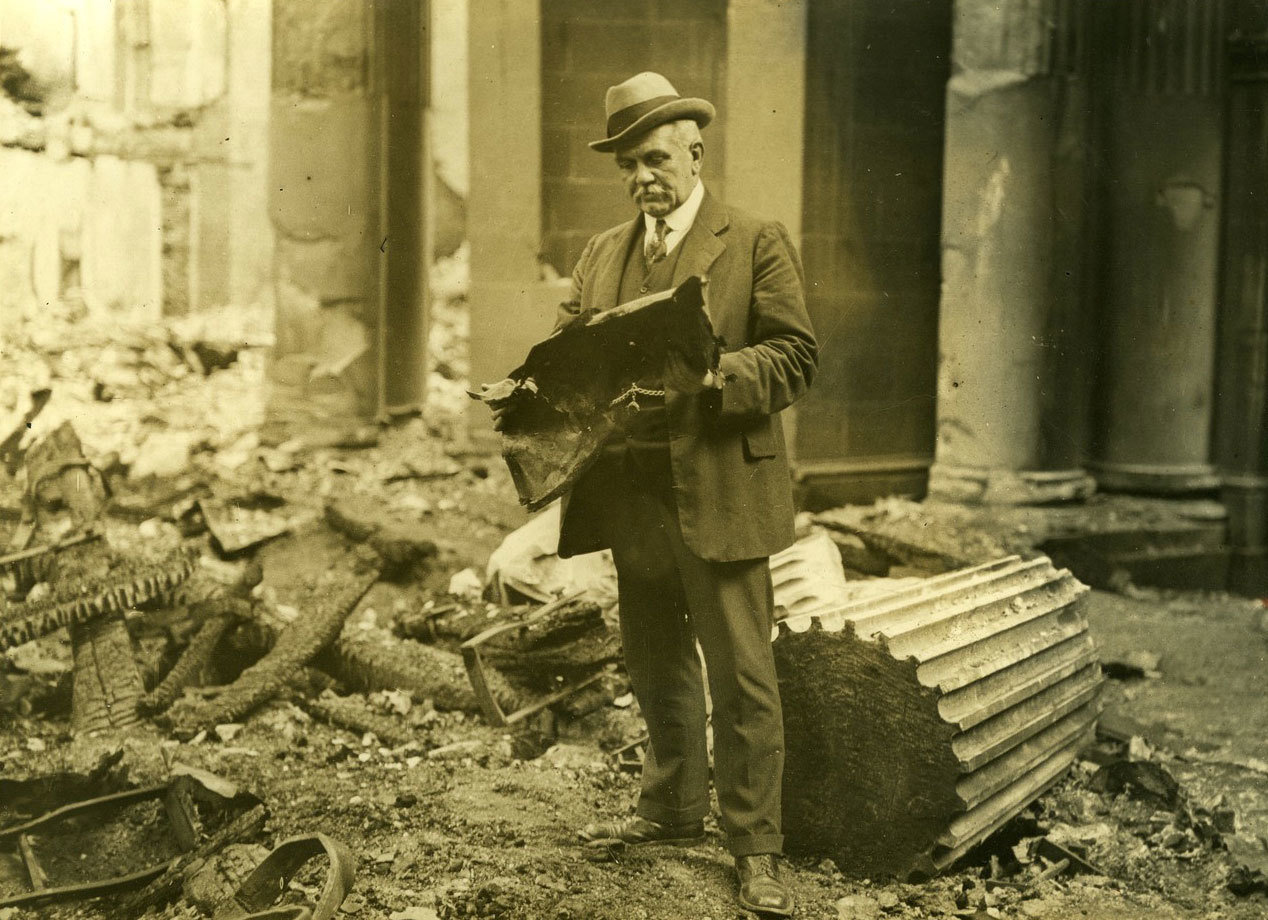 A gentleman standing in the ruins of part of the Four Courts, 1922, W.D. Hogan, UCD School of History and Archives, CC BY-NC-SA