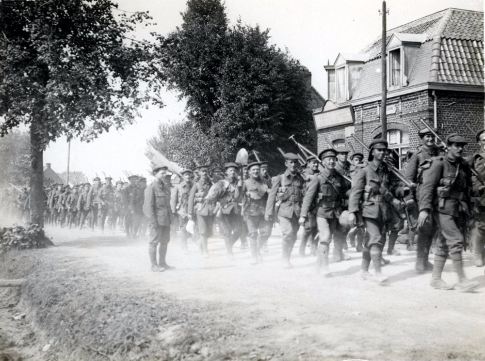 British infantrymen on their way to the trenches, 1915-08-28 Estaires, France, The British Library, Public Domain Mark