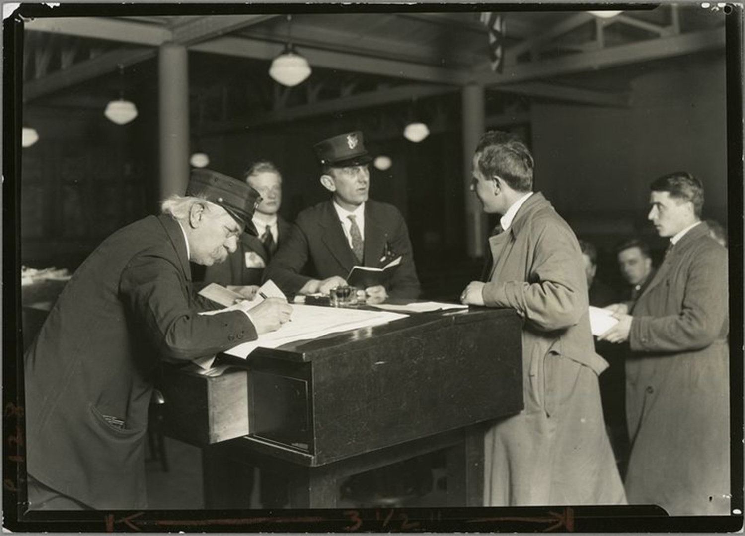 Interpreter and recorder interviewing newcomers, Ellis Island, New York, Hine, Lewis Wickes 1908, NYPL Digital Gallery, Public Domain Mark