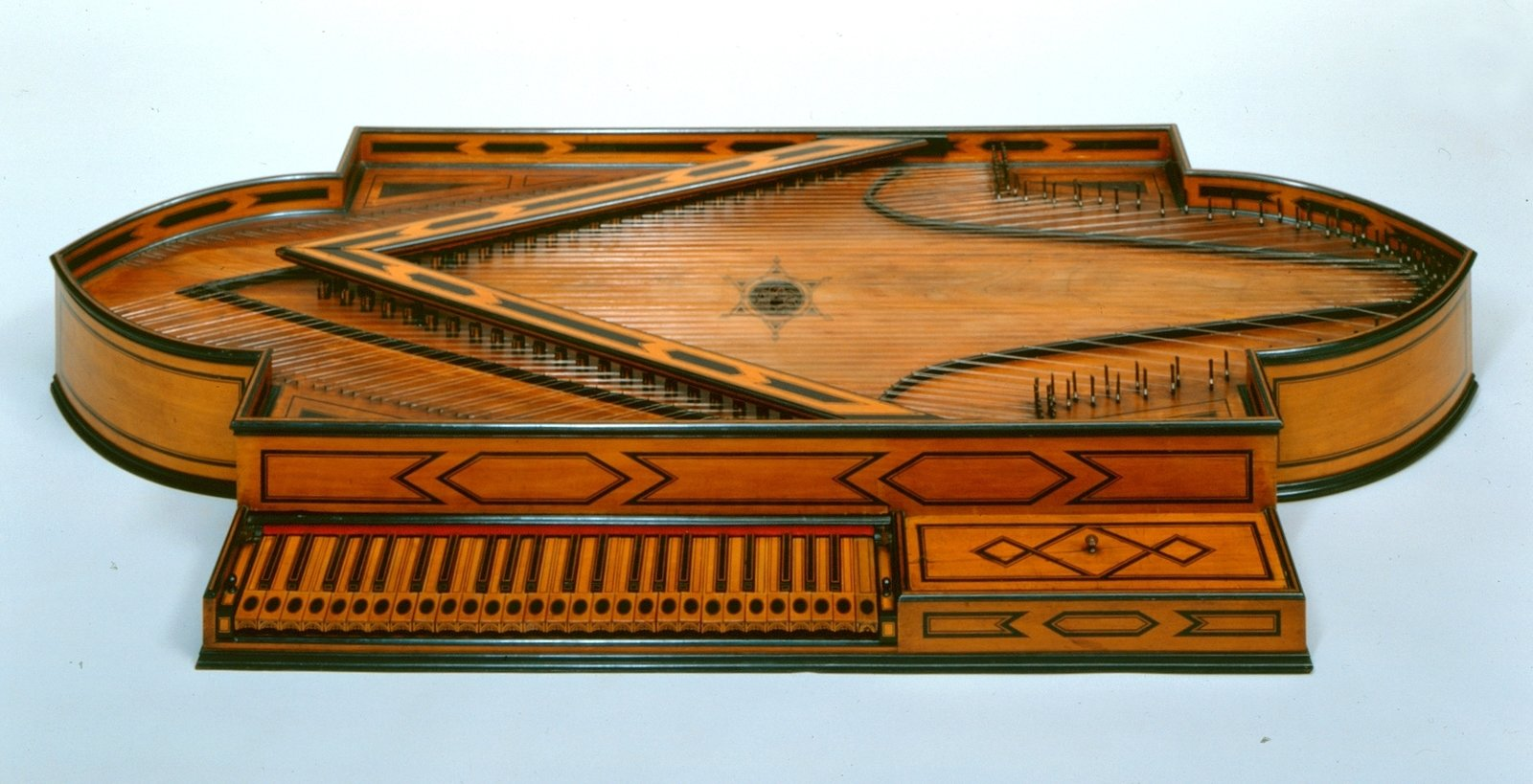 Spinett, 1693, Bartolomeo Cristofori, [The unique instrument is a fantastic example of the creative powers of Bartolomeo Cristofori and was made a few years before his invention of the pianoforte. It blends ingenious design and technical solutions with virtually unsurpassable craftsmanship. With this instrument, he managed to combine the benefits of the harpsichord (use of a double course, long bass scale) with the more intimate shape of a spinet in a visually pleasing form. Cristofori only built two known models of this type, a harpsichord in 1690 and the instrument described here in 1693. Both instruments were made for Ferdinand de Medici, the eldest son of the Grand Duke of Tuscany, Cosimo III. de Medici.], Museum für Musikinstrumente der Universität Leipzig, CC BY-NC-SA