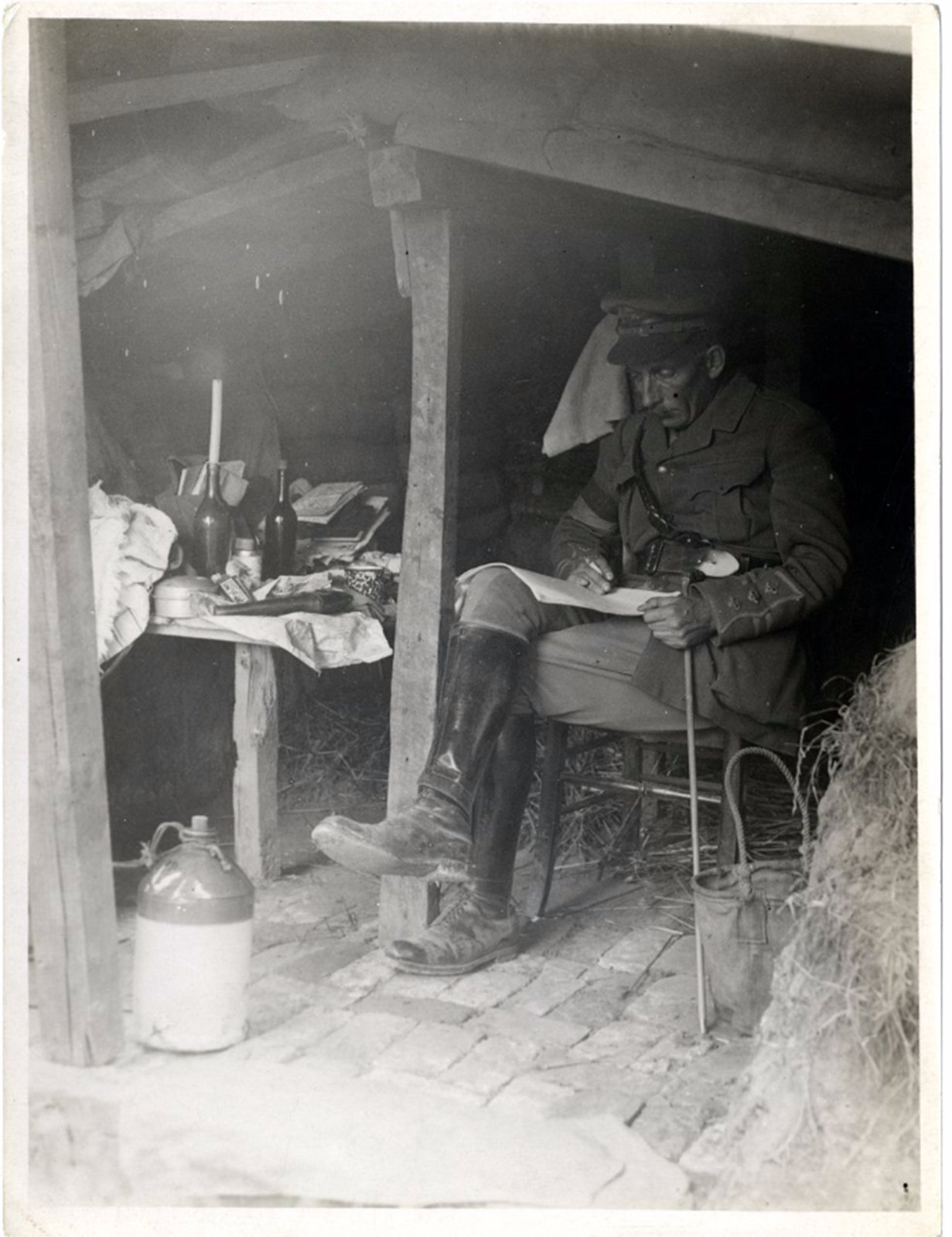 A British Officer reading papers in a dugout, H. D. Girdwood 1915-08-09, The British Library, Public Domain Mark