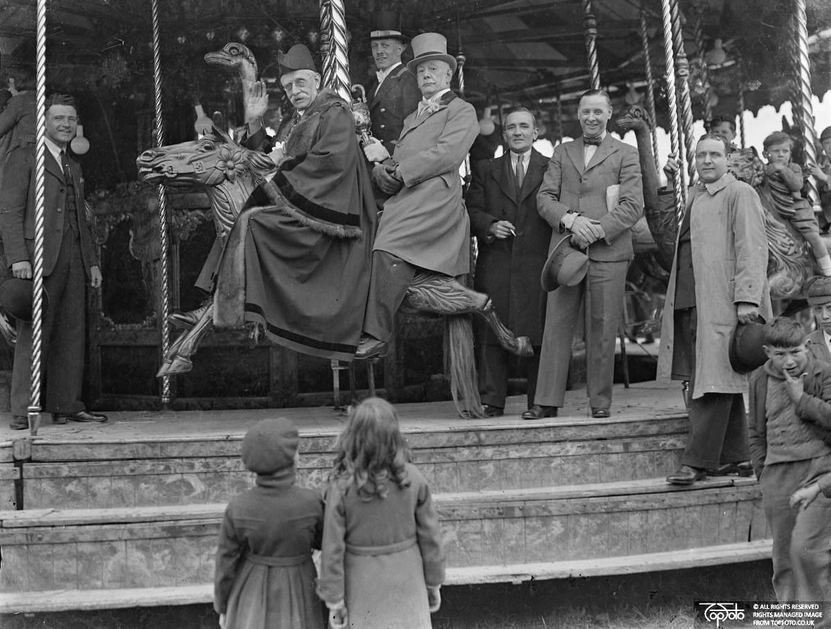 The Mayor opens the old May Fair at Heston and rides the roundabouts, May 1st 1936, Photographer unknown, TopFoto.co.uk, In Copyright
