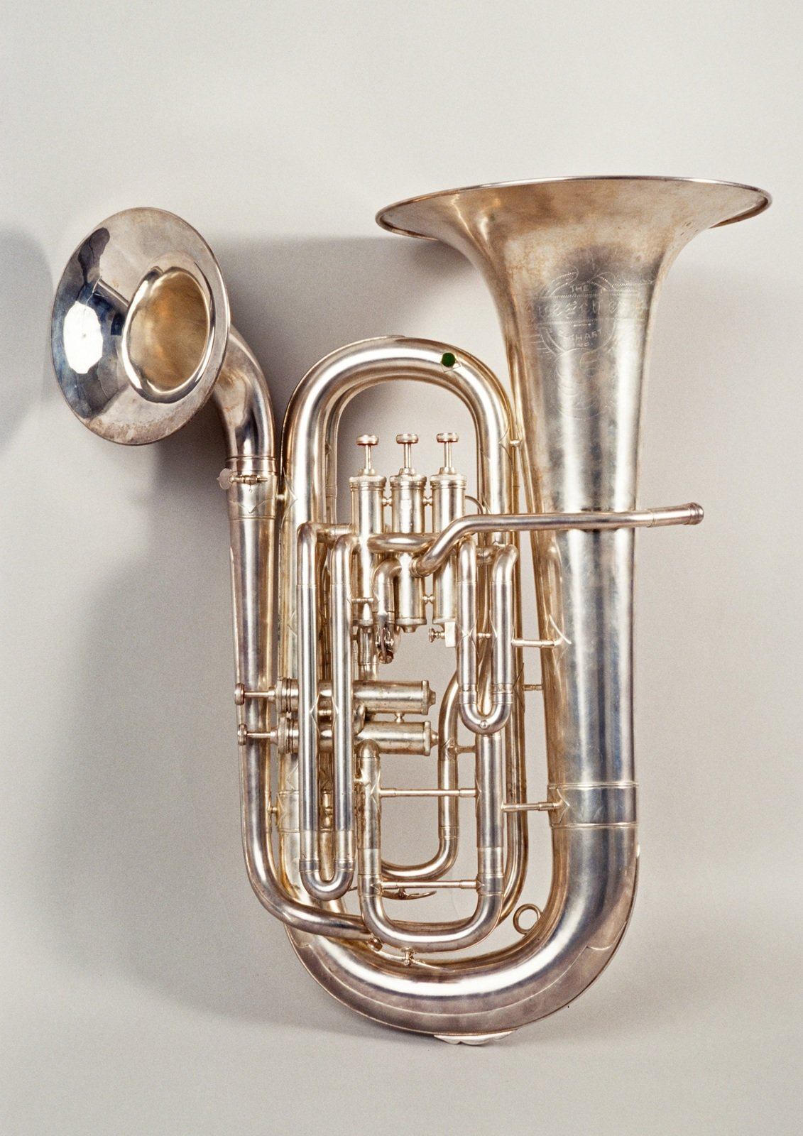 Double-bell euphonium, 1913, Buescher, [The fifth valve switches the windway to the smaller bell, allowing the player to change from the sound of a euphonium to something like the sound of a trombone.], University of Edinburgh, CC BY-NC-SA