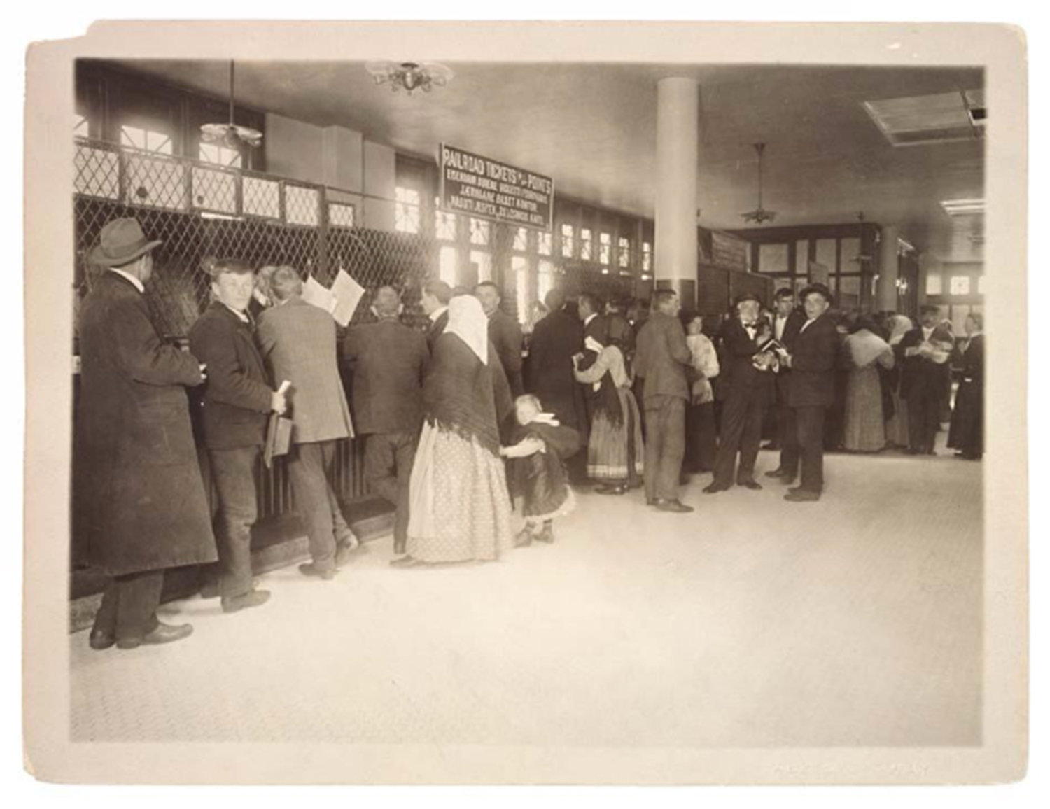 Immigrants Buying Railroad Tickets on Ellis Island, Department of the Treasury. Public Health Service.	(1912 - 07/01/1939), Online Public Access NARA, Public Domain Mark