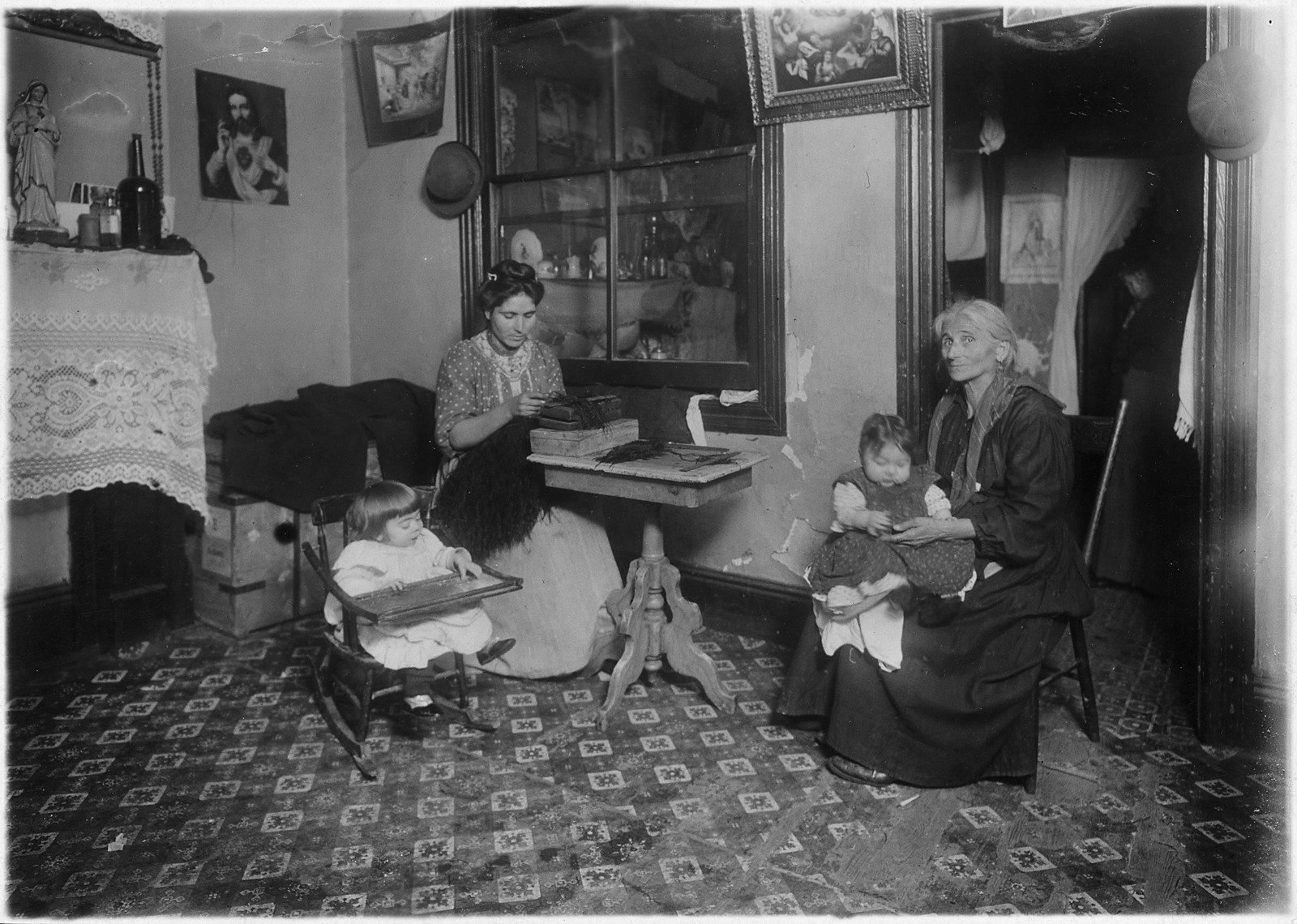 Mrs. Larocca making willow plumes in an unlicenced tenement., Department of Commerce and Labor. Children's Bureau.	(1912 - 1913), NARA Online Public Access, In Copyright