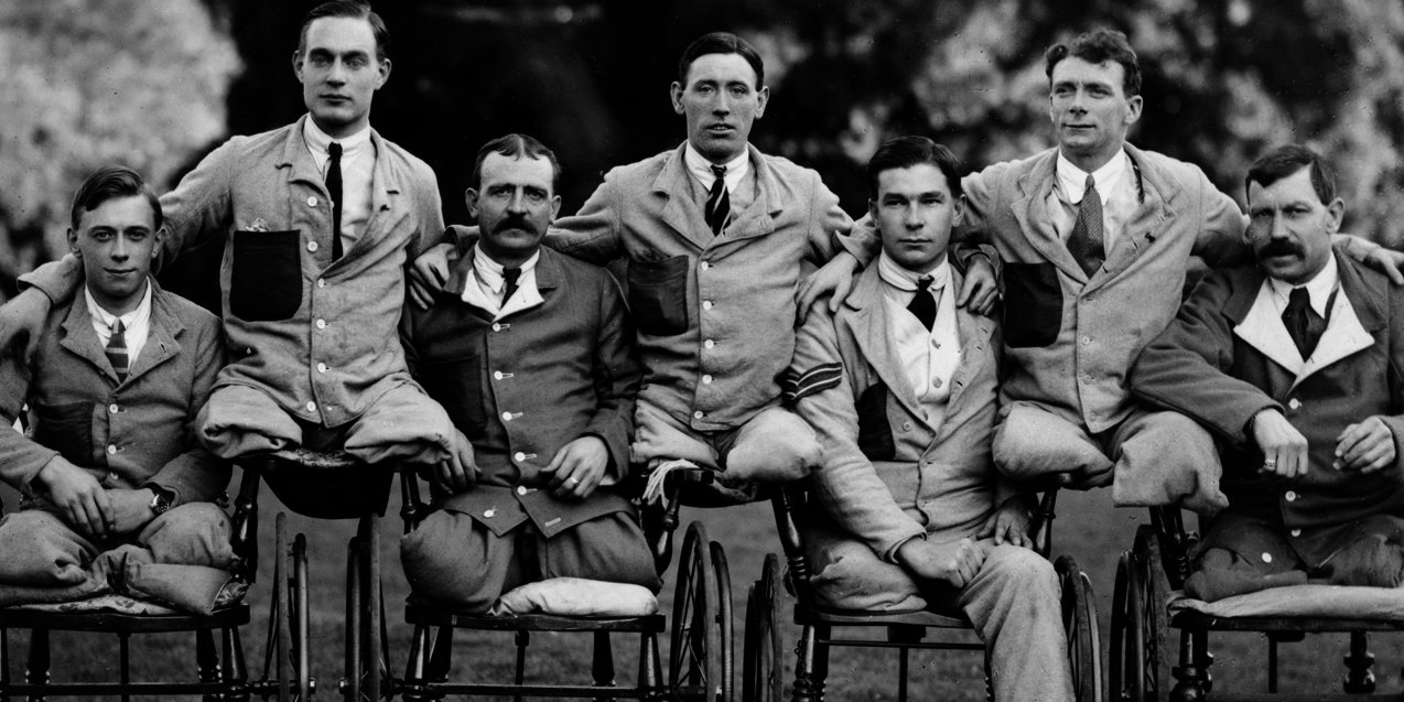"Servicemen with missing limbs in wheelchairs at Roehampton Military Hospital. Note the soldiers are wearing ""Hospital Blues""., , IWM, CC BY-NC"