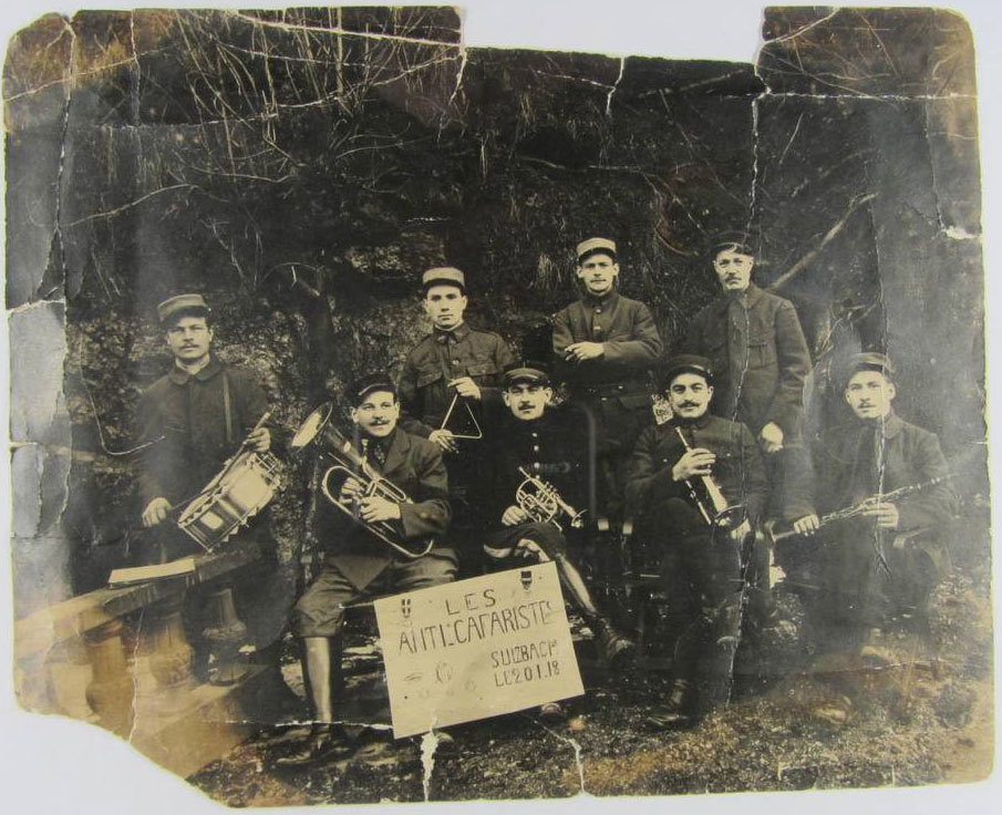 Photograph of a band of French musicians 'Les Anti-cafaristes', taken in the POW camp in Aremberg in Bavaria, Germany, unknown photographer, Europeana 194-1918 / Frédéric Guibert, CC BY-SA