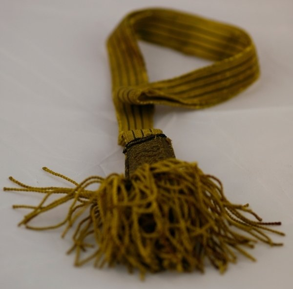 "Swordknot or ""portepee"" – a decorative item tied to the wearer's weapon to signify a certain unit or section, item found in knapsack of Victor Mitkiewicz, Europeana 1914-1918 / Silvester Kovačič, CC BY-SA"