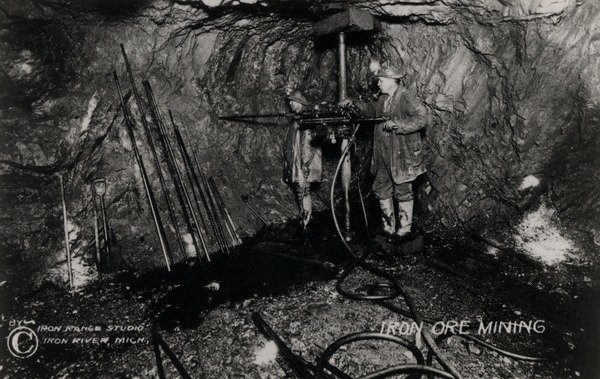 Iron ore mining, Two miners operating a drill in an underground cavern,  Iron River Michigan., Immigration History Research Center Archives (IHRC Archives) , In Copyright