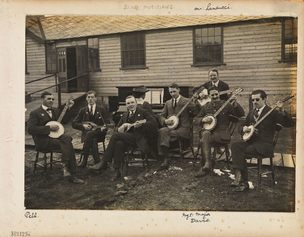 A band of seven blinded players playing the banjo [1919], unknown photographer, Wellcome Collection, CC BY