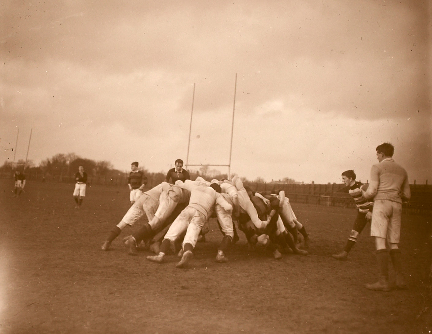 Rugby players in a scrum, ca.1890-1910, John J. Clarke, National Library of Ireland, In Copyright