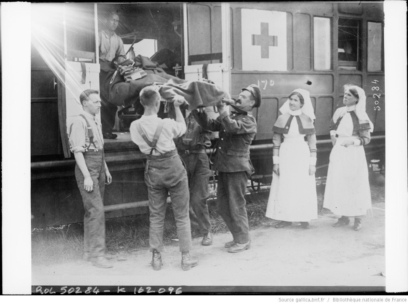 In Flanders: the wounded are being loaded into the train, Agence Rol. Agence photographique, French National Library - Bibliothèque Nationale de France, Public Domain Mark