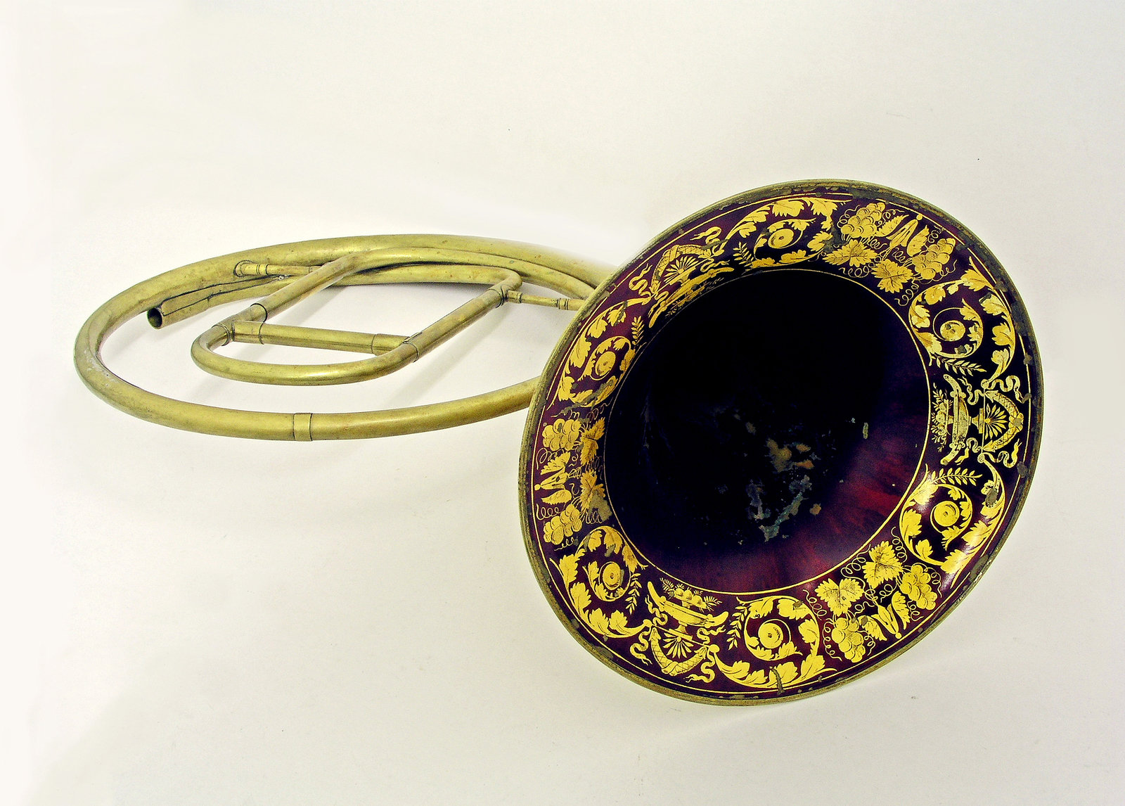 Hand Held French Horn, c.1840, Courtois neveu, [This is a typical orchestral horn of the early nineteenth century with crooks (not shown) to allow it to play in the most common tonalities. It is played with the hand in the bell. The lacquer decoration of the bell was common in France at that time.], University of Edinburgh, CC BY-NC-SA
