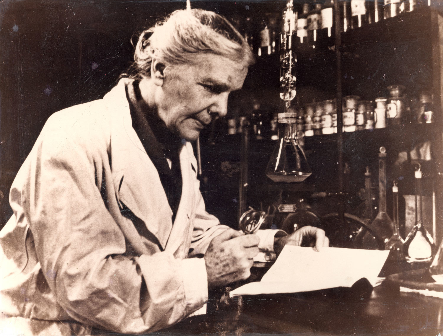 "Eng. Elisa Leonida Zamfirescu processing scientific data obtained from laboratory investigations, Unknown photographer, National Technical Museum ""prof.ing. Dimitrie Leonida"", Bucharest, CC0"